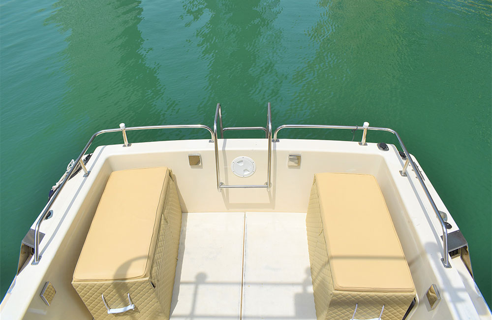 Cozy outdoor sitting area on back of yacht gives an opportunity to enjoy dubai panoramic views