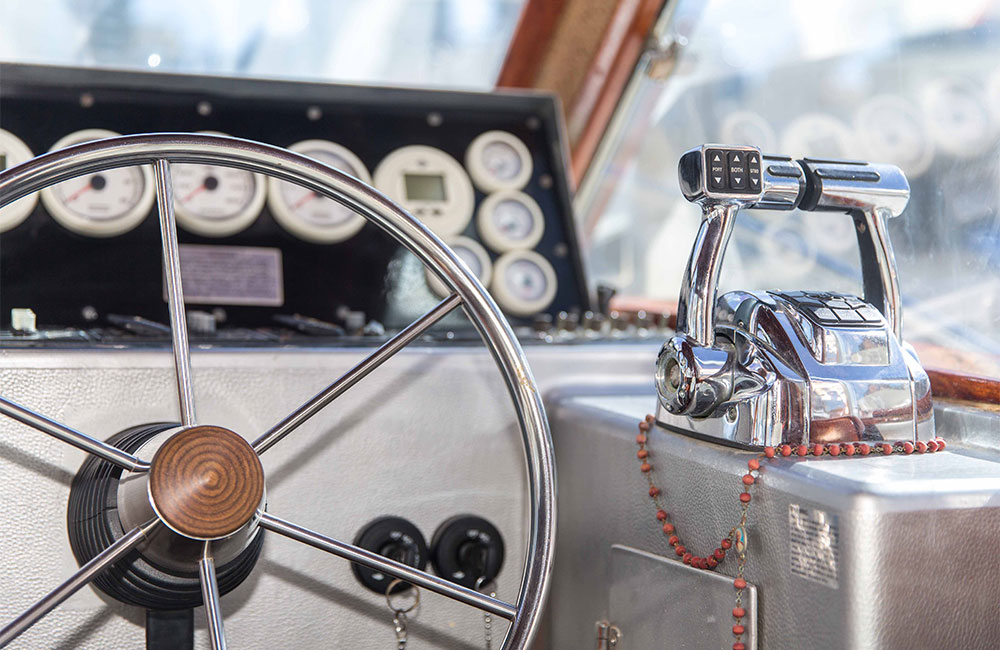 Glamorous interior of fishing boat having stainless steel steering wheel