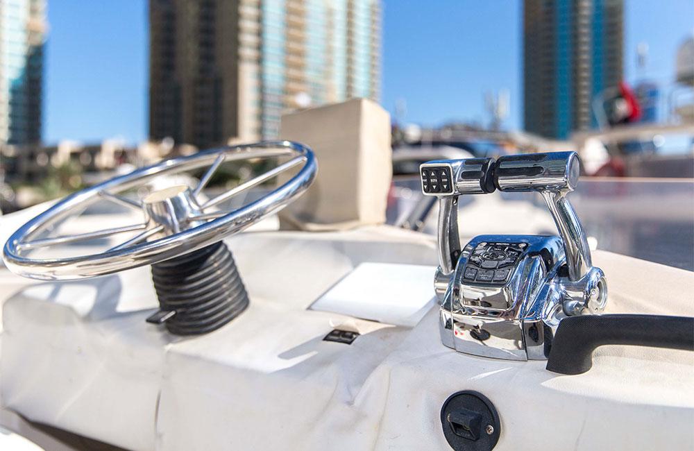 Flybridge steering station of 33 feet private yacht at Dubai Marina