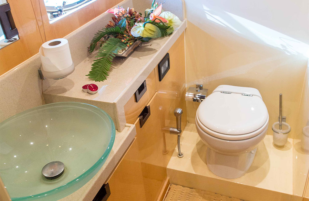 modern toilet with built-in sink and lights