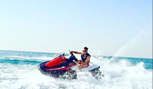 Boy enjoying thrilling Yamaha Waverunners 1100cc jet ski in Dubai