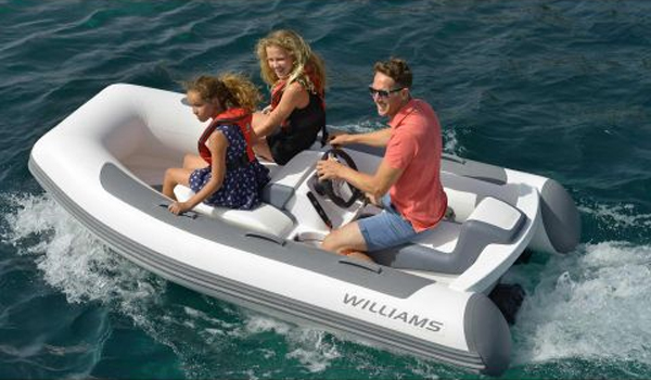 Family relishing the stunning sea views on high speed jet boat in Dubai Marina